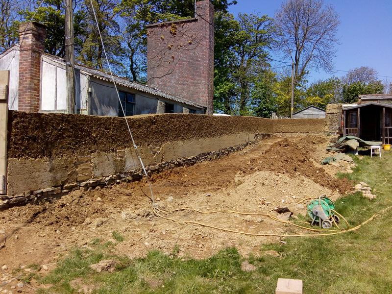 rebuilding cob wall